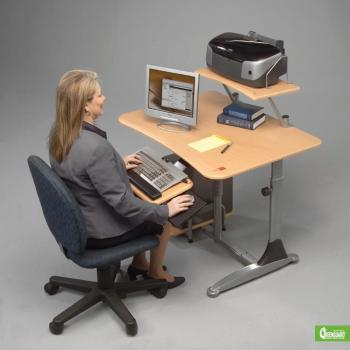 A woman is seated at a sit down or stand up adjustable computer workstation.