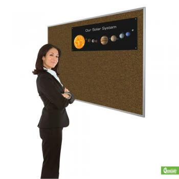 A woman is shown standing in from of a large cork board for wall mount in blue.