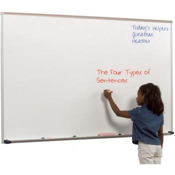 A laminate dry erase whiteboard is shown being drawn on by a child. It features an aluminum tray with rubber caps for safety and a full length accessory tray.