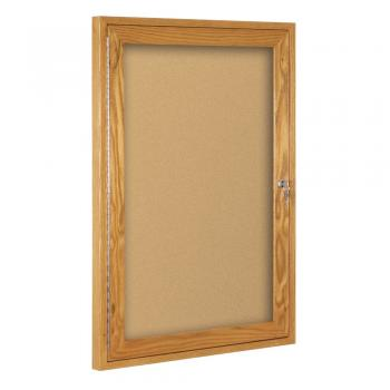 An oak framed enclosed cork board is shown with acrylic cover/