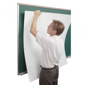 A man turns an ordinary black board into a dry erase whiteboard with the easy peel and stick dry erase wall covering. It sticks to any board to create a dry erase white board.