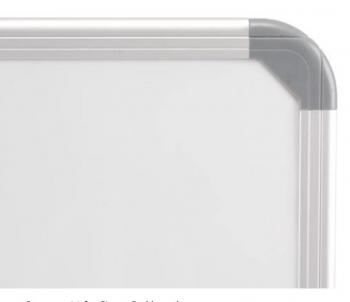 The wall mounted dry erase magnetic board has rounded corners.