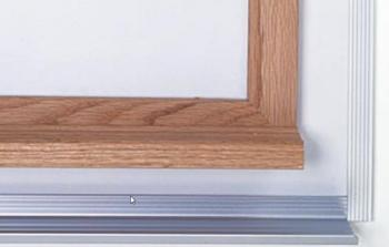 Close up of wooden frame for classroom whiteboard that is available in many sizes.