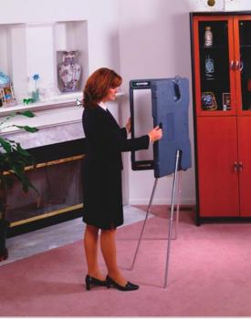 A lady is unfolding a portable presentation whiteboard.