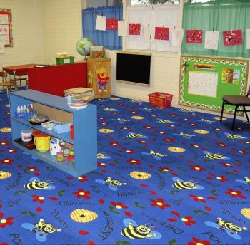 A far away view of the Mr. Bee childrens rug.