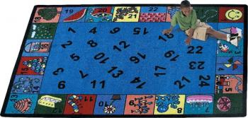 A rectangle shaped blue kindergarten classroom rug.