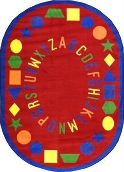 An oval shaped red alphabet preschool rug for the classroom.