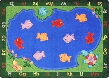 A rectangular shaped kids floor rug with fish.