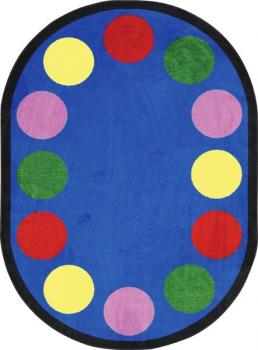 Displayed is a small oval rug is shown. It has dots for 12 students.