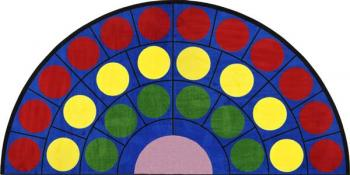 A view of the end of the large oval rug shows us how, by adding more dots in outside rings, its can hold many more students.