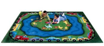The Puddle Ducks educational rug is seen from the side. It is made from materials that are healthy and safe for your child.