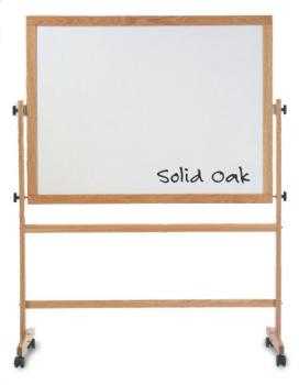 Displayed is a magnetic dry erase school room white board in a wooden frame. A full length accessory tray runs beneath the board.