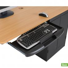 A single person computer workstation is displayed highlighting the retractable keyboard tray.