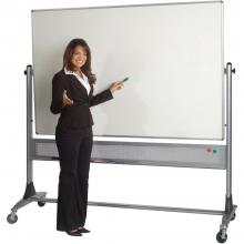 A teacher stands beside a rolling double sided dry erase board.