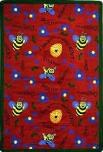 A rectangle shaped red childrens rug with bees for the classroom.