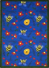 A rectangle shaped blue childrens rug with bees for the classroom.