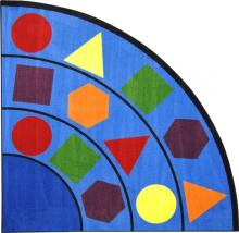 A corner shaped kids carpet rug with shapes for a classroom is displayed.