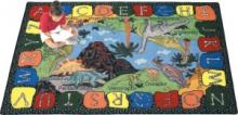 A dinosaur alphabet rug for a classroom is displayed.