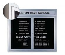 An aluminum framed business message board with two locking tempered glass doors.