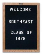 A wooden framed directory board sign with lettering.