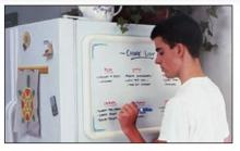 A small dry erase board comes pre installed with hangers, but can also have magnets attached to attach to a door or refrigerator.