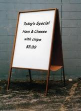 The dry erase sandwich board is a free standing double sided whiteboard available in an oak or walnut wood frame finish.