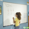 A child works math problems on the magnetic dry erase classroom whiteboard with aluminum frame.